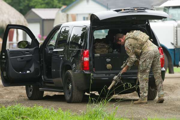 Authorities surround a suspect who barricaded inside a pickup truck after leading Houston Police in a high speed chase Thursday, June 22, 2017, near Needville, Texas.