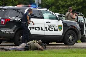 Authorities surround a suspect on FM 1994 near Highway 36, who barricaded inside a pickup truck after leading Houston Police in a high speed chase Thursday, June 22, 2017, near Needville, Texas.
