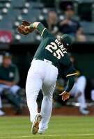OAKLAND, CA - JUNE 21:  Ryon Healy #25 of the Oakland Athletics catches a pop-up off the bat of Norichika Aoki #3 of the Houston Astros in the top of the fifth inning at Oakland Alameda Coliseum on June 21, 2017 in Oakland, California.  (Photo by Thearon W. Henderson/Getty Images)