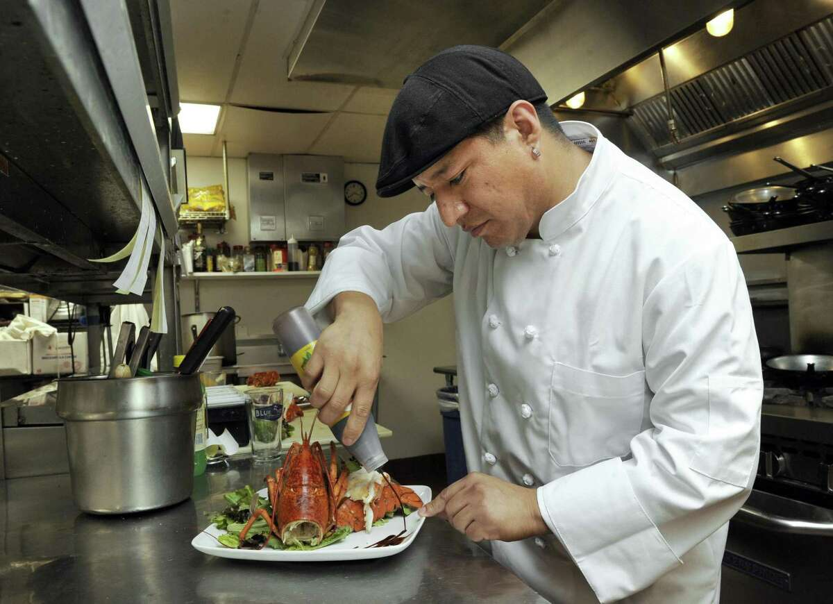 Julio Cevallo, chef and co-owner of Angora, a new restaurant in Brookfield, prepares a lobster dish Tuesday, June 20, 2017.