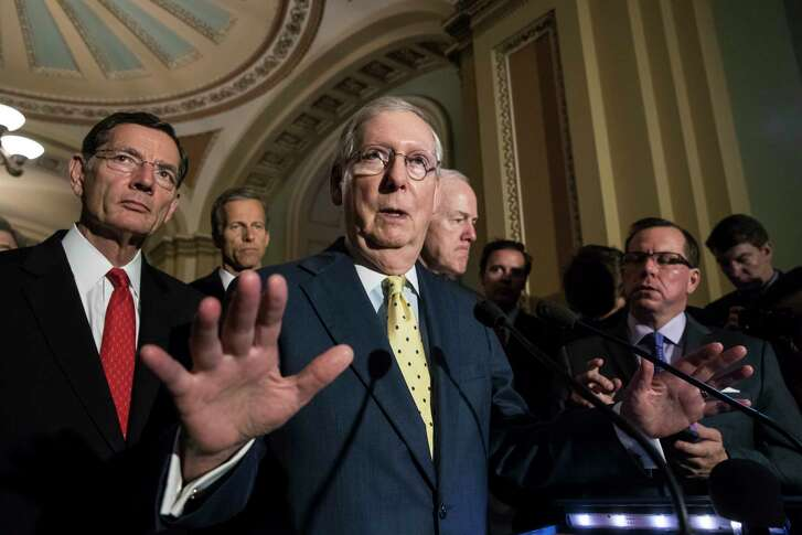 """Senate Majority Leader Mitch McConnell, R-Ky., joined by, from left, Sen. John Barrasso, R-Wyo., Sen. John Thune, R-S.D., and Majority Whip John Cornyn, R-Texas, speaks following a closed-door strategy session, at the Capitol in Washington, Tuesday, June 20, 2017. Sen. McConnell says Republicans will have a """"discussion draft"""" of a GOP-only bill scuttling former President Barack Obama's health care law by Thursday."""