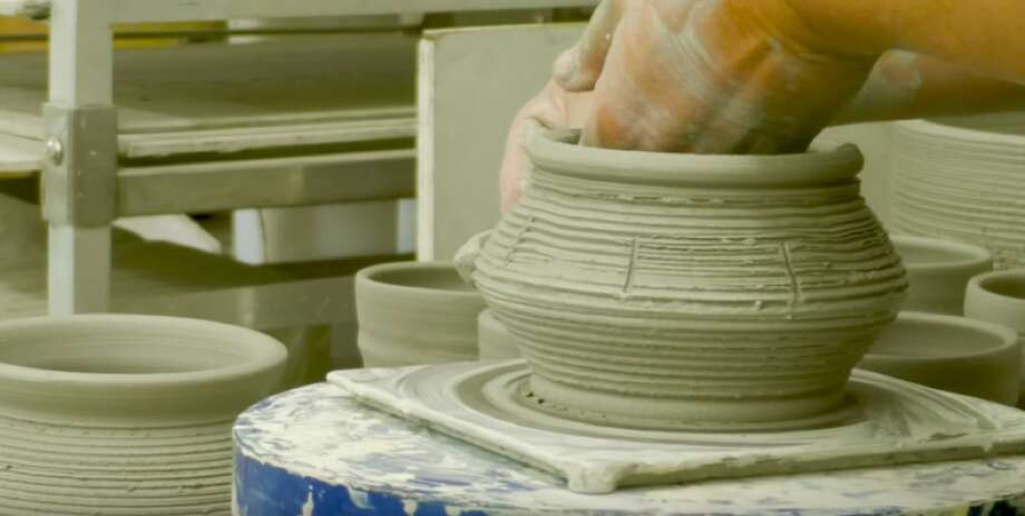 "Ceramicist Diana Kersey ""plays with mud"" for a living. The artist works with her hands to create bright, sturdy pieces of pottery. Photo: By Lindsey Gawlik, San Antonio Express-News"