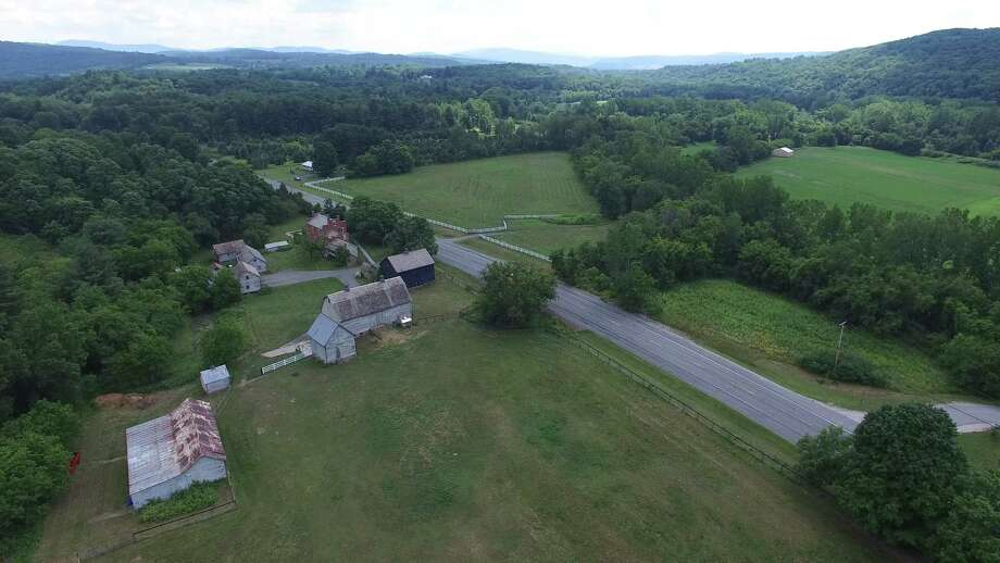 The equestrian estate at 22420 State Route 22, Eagle Bridge is 110 acres. There is a barn on the property already suitable for 5 to 9 horses, paddocks, and room for a indoor arena. List price: $1.3 million.
