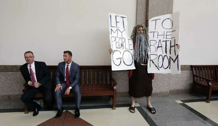 "John Erler protests as the Senate State Affairs Committee begin hearings about Senate Bill 6 at the Texas Capitol, Tuesday, March 7, 2017, in Austin, Texas. The the transgender ""bathroom bill"" would require people to use public bathrooms and restrooms that correspond with the sex on their birth certificate. (AP Photo/Eric Gay) Photo: Eric Gay, STF / AP / Copyright 2017 The Associated Press. All rights reserved."