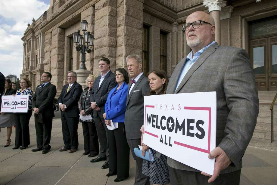 """FILE - In this Jan. 11, 2017, file photo, Brad Kent, Chief Sales and Services Officer for Visit Dallas, holds at sign a news conference at the Capitol in Austin, Texas, to oppose Lt. Gov. Dan Patrick's bathroom bill. Texas has been a prime location for major sports and entertainment events, but a """"bathroom bill"""" proposed in the state legislature could put that status in question. The bill would require people to use public bathrooms that correspond to the sex on their birth certificate. (Jay Janner/Austin American-Statesman via AP, File)/Austin American-Statesman via AP) Photo: Jay Janner, MBO / Associated Press / Internal"""