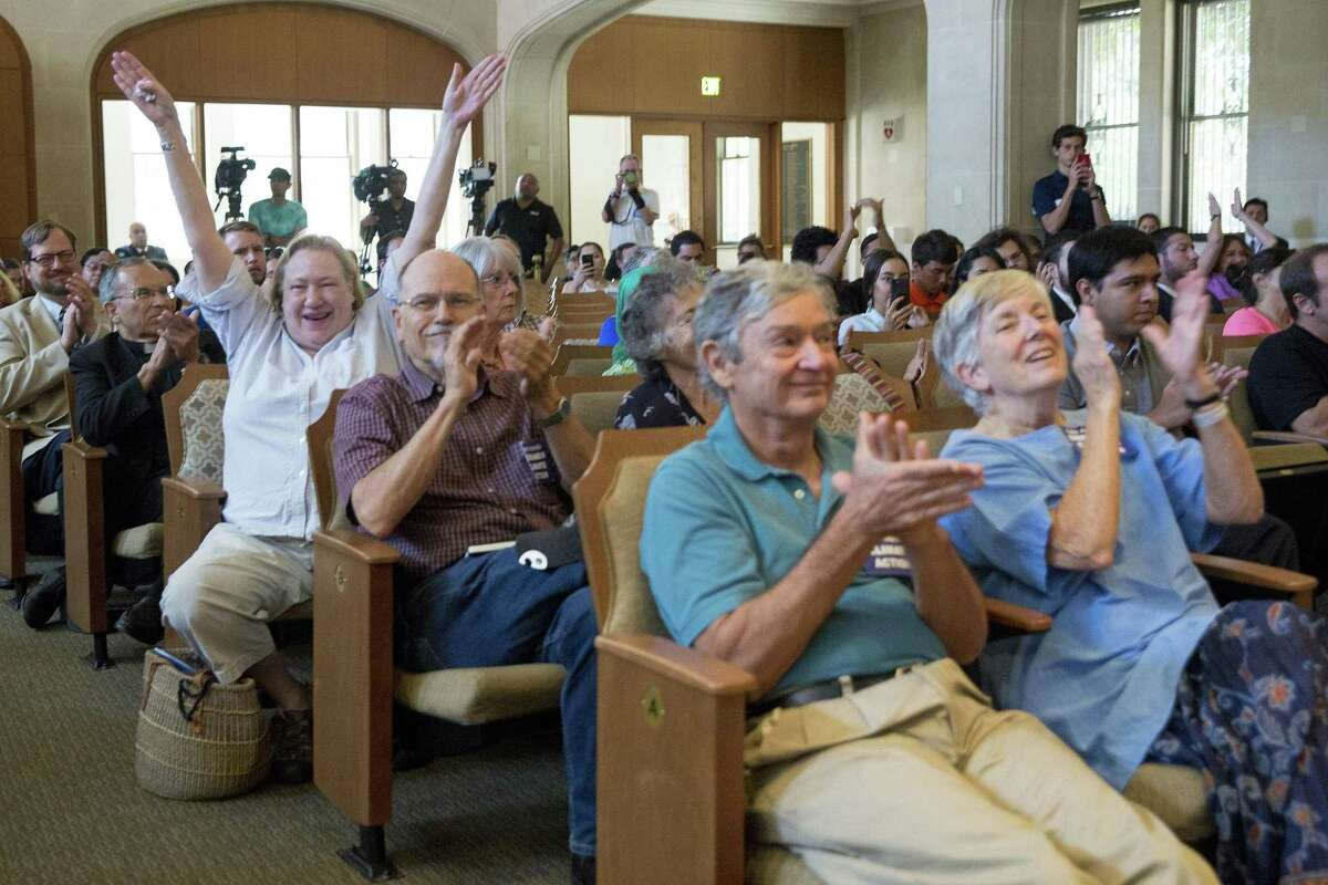 People celebrate after the San Antonio City Council passed a resolution in support of the Paris Climate Agreement on June 22, 2017.
