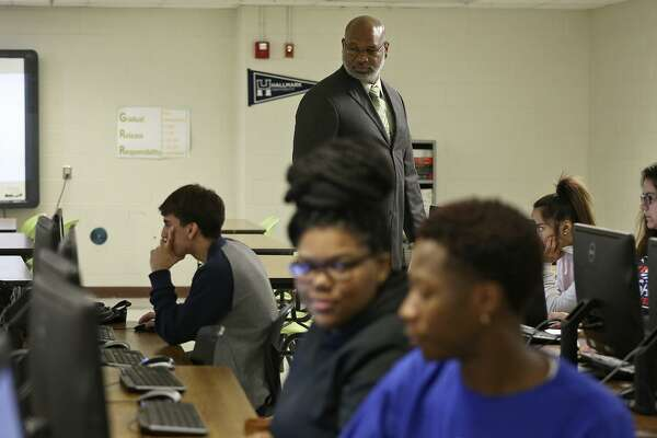 Sam Houston High School Principal Darnell White walks around a STEAM class in the New Tech program at the school on November 30, 2016.