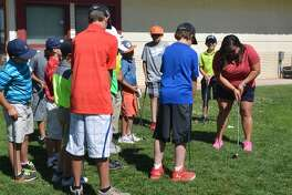 Plainview High School girls' golf coach Annette Garcia, right, teaches the correct technique for putting during the Plainview Boys' and Girls' Junior Golf Camp last year. This year's camp will be next week from Tuesday through Thursday. The deadline to register is Sunday.