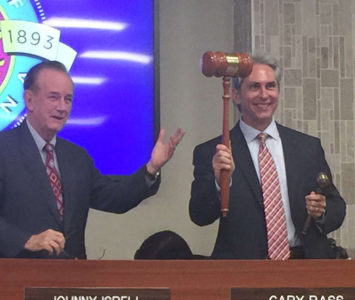 Former Pasadena Mayor Johnny Isbell, left, passes the gavel to City Councilman Jeff Wagner, his successor. Wagner has not made a decision about continuing the city's appeal in a voting rights case.