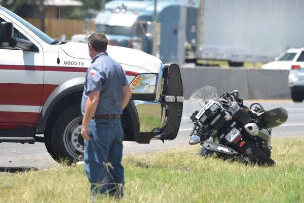 A Bexar County Sheriff's deputy was hospitalized Thursday after he crashed his motorcycle while chasing a speeding motorist on U.S. 281.