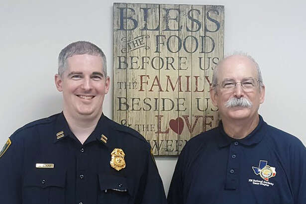 New HPD-Kingwood Division Captain Jacob Atkins and his father, retired Lt. Don Atkins, pose for photos during the Kingwood PIP meeting at the Kingwood Church of Christ on Tuesday, June 20.