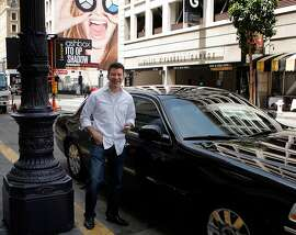 CEO of Uber Travis Kalanick with one of the car Uber service uses to drive customers in San Francisco, Calif. on May 1, 2012.
