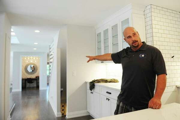 Contractor Jerry Riberio shows the open design of the newly-renovated home at 6 Stallion Trail off North Street in Greenwich, Conn. Wednesday, June 21, 2017. The 1981 home was recently renovated with a more more modern look by Second Wind Homes with contractor Jerry Ribeiro and the home is now listed at $2.39 million through Berkshire Hathaway Home Services.