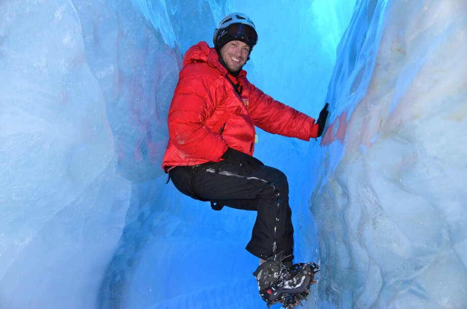 Lee Abbamonte, who has visited more than 100 countries alone, explores the ice caves beneath the surface of Queen Maud Land in Antarctica. MUST CREDIT: Handout courtesy of Lee Abbamonte. / Handout