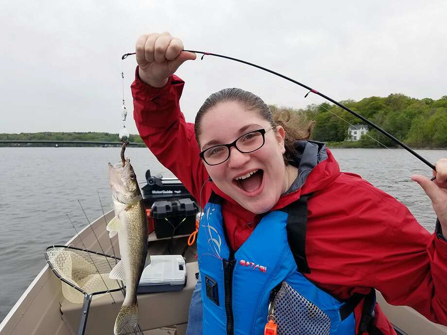 Sara Kirkpatrick with a catch-of-the-day, using equipment borrowed from the Bethlehem Public Library.