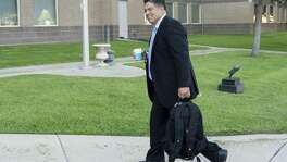 Newly elected District 8 councilman Manny Palaez enters the federal courthouse in Del Rio Thursday, June 22, 2016 as he prepares to testify in the federal  bribery, wire fraud and conspiracy trial against former Crystal City manager/attorney James Jinas III and former mayor Ricardo Lopez.