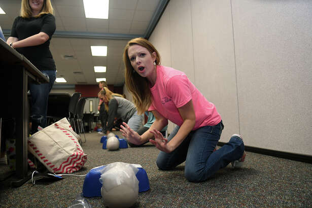 "Laura Keene, a stay-at-home mom and former teacher at Canyon Pointe Elem., ""shouts for help"" during her CPR/AED and First Aid Certification class at the Tomball ISD Staff Development Center in Tomball on June 20, 2017. (Photo by Jerry Baker/Freelance)"