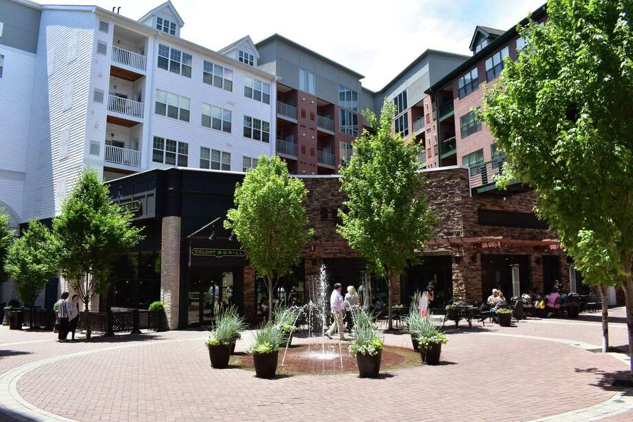 Patrons of Colony Grill and Sedona Taphouse take in a sunny day on Thursday, June 22, 2017, at the interior courtyard of Pointe Place Market at the Waypointe development in Norwalk, Conn. Opening in 2015, the two restaurants were joined by Barcelona in 2016, but leasing activity has since slowed. Photo: Alexander Soule / Hearst Connecticut Media / Stamford Advocate