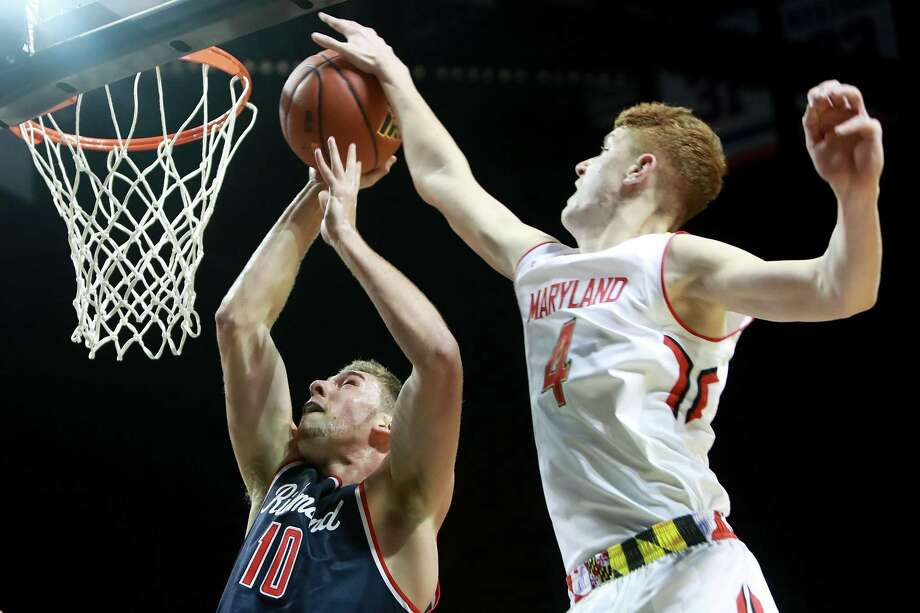 NEW YORK, NY - NOVEMBER 25:  Kevin Huerter #4 of the Maryland Terrapins blocks T.J. Cline #10 of the Richmond Spiders in the second half during the Barclays Center Classic at Barclays Center on November 25, 2016 in the Brooklyn borough of New York City.  (Photo by Michael Reaves/Getty Images) ORG XMIT: 682703973 Photo: Michael Reaves / 2016 Getty Images