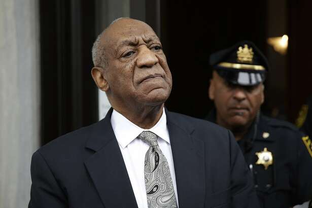 FILE - In this Saturday, June 17, 2017, file photo, Bill Cosby exits the Montgomery County Courthouse after a mistrial was declared in his sexual assault trial in Norristown, Pa. Judge Steven O'Neill who presided over Cosby's sexual assault trial is weighing whether to make public the identities of the jurors who deadlocked in the case. He said he would rule by Wednesday, June 21. (AP Photo/Matt Rourke)