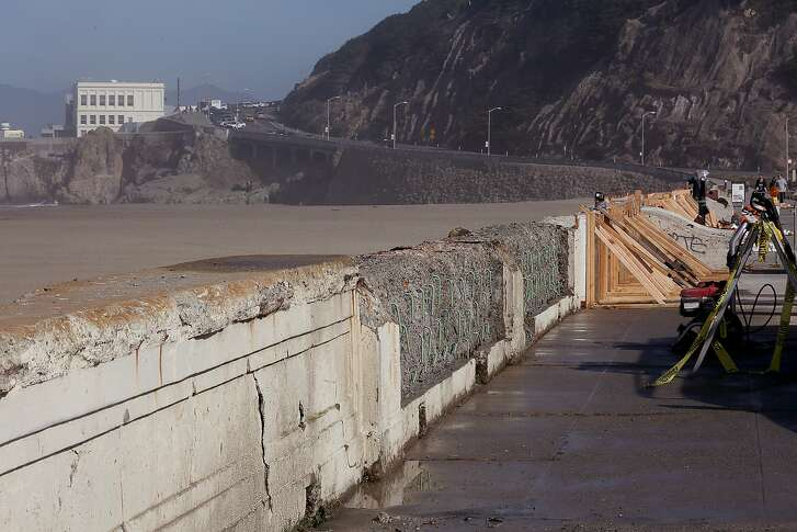 Different stages of work being done on the nearly 100-year-old O'Shaughnessy Seawall at Ocean Beach in San Francisco, California, by the The Historic Preservation Training Center (HPTC) on Thursday March 19, 2015.  On left is damaged seawall planned to be removed, behind it is deteriorated rebar replaced with green non-rust reinforcing rods, at far right is HPTC forming the wall for new cement.
