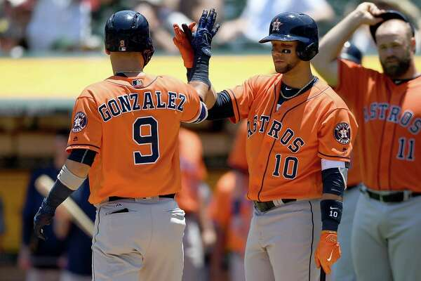 OAKLAND, CA - JUNE 22:  Marwin Gonzalez #9 of the Houston Astros is congratulated by Yuli Gurriel #10 after Gonzalez hit a three-run homer against the Oakland Athletics in the top of the second inning at Oakland Alameda Coliseum on June 22, 2017 in Oakland, California.