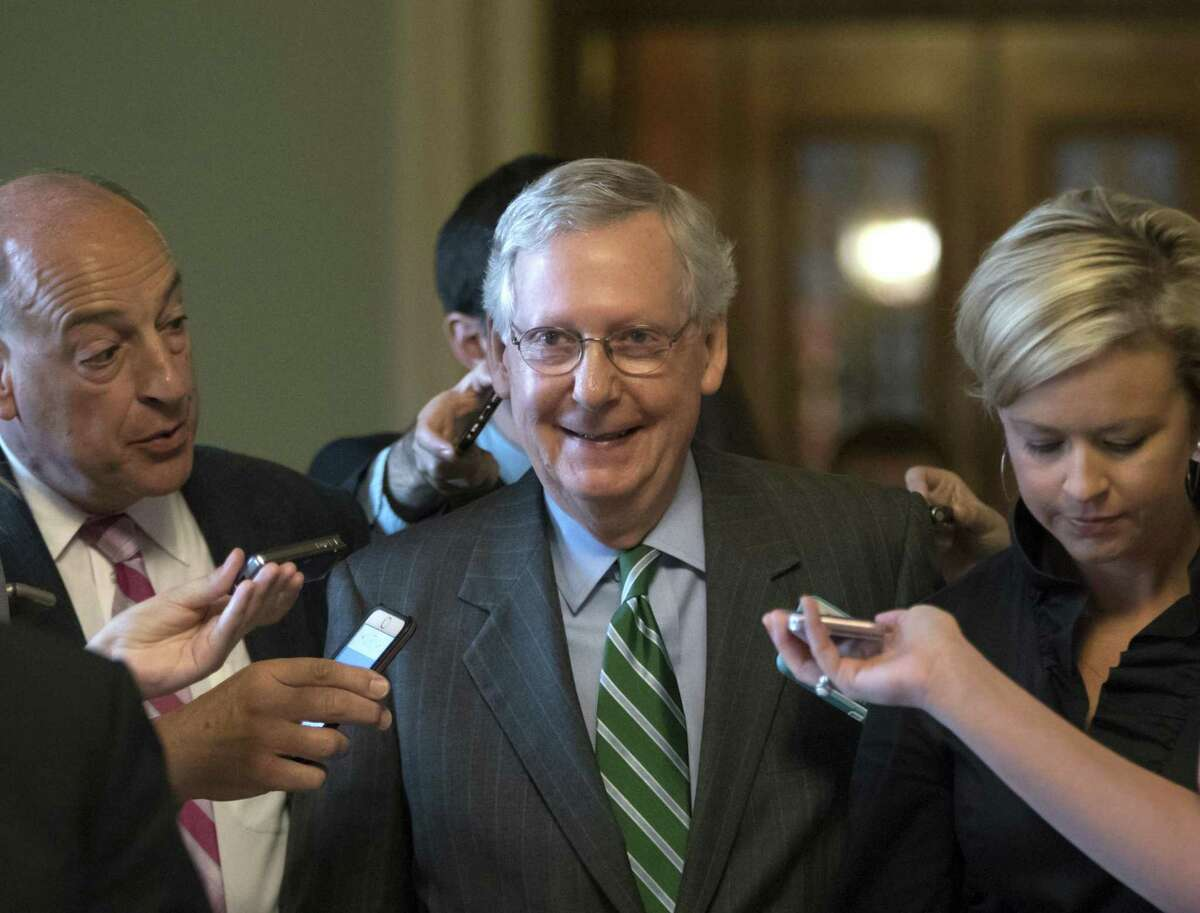 Senate Majority leader Mitch McConnell smiles as he leaves the chamber after announcing the release of the Republicans' healthcare bill at the Capitol in Washington, D.C. on Thursday. The measure represents the Senate GOP's effort to achieve a top tier priority for President Donald Trump and virtually all Republican members of Congress.