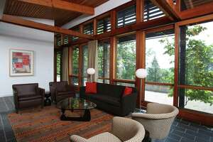 A contemporary house at 32 Mountain Road in Kent, Conn. won an American Institute of Architects award. The owners designed the home with architects to be one with nature.