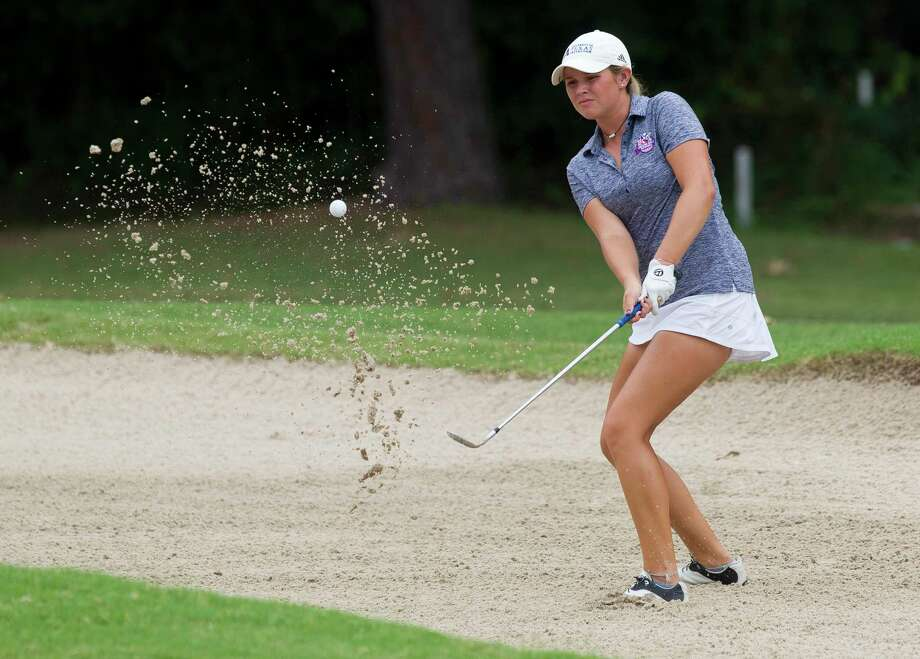 Ava Schwienteck, of Magnolia, hits out of a bunker near the 16th green during the final round of the American Junior Golf Association Junior Championship at The Woodlands County Club Tournament Course, Thursday, June 22, 2017, in The Woodlands. Photo: Jason Fochtman, Staff Photographer / © 2017 Houston Chronicle