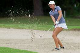 Ava Schwienteck, of Magnolia, hits out of a bunker near the 16th green during the final round of the American Junior Golf Association Junior Championship at The Woodlands County Club Tournament Course, Thursday, June 22, 2017, in The Woodlands.