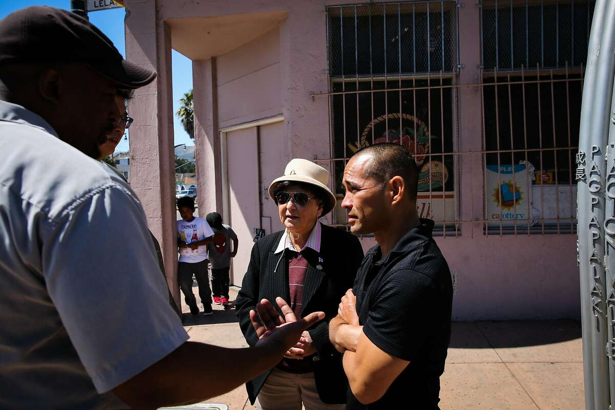 (l-r) Community advocate Russel Morine and spokeswoman for the Visitation Valley Asian alliance Marlene Tran chat with executive director of Real Options for City Kids Curt Yagi (right) outside a building that is being proposed to become a medical marijuana dispensary in San Francisco, California, on Wednesday, June 21, 2017. They are all opposed to the dispensary.