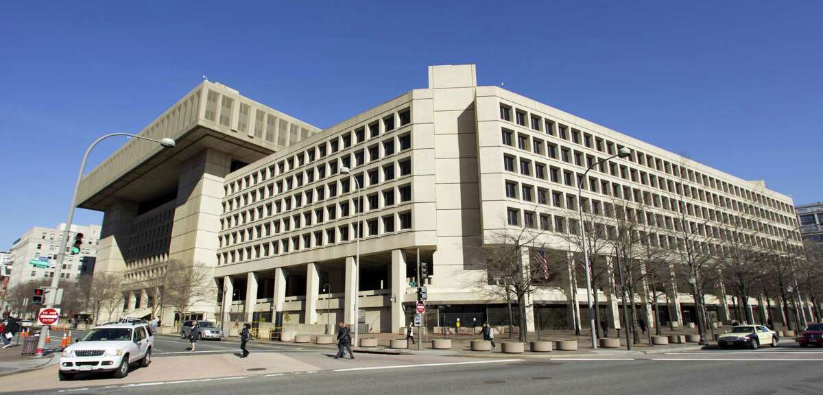 File photo of the Federal Bureau of Investigation (FBI) headquarters in Washington. Texans filed roughly 21,000 complaints and reported losing about $77.1 million to internet crimes last year, the fourth-biggest reported loss, according to the report.