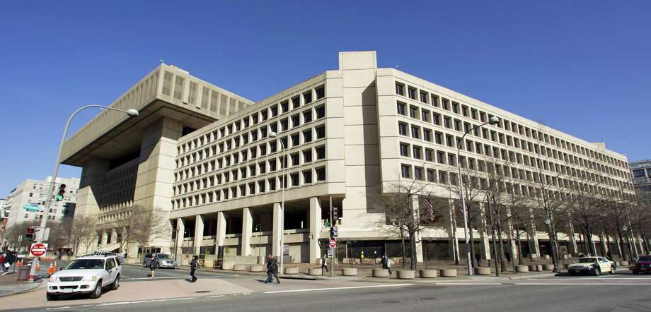 File photo of the Federal Bureau of Investigation (FBI) headquarters in Washington. Texans filed roughly 21,000 complaints and reported losing about $77.1 million to internet crimes last year, the fourth-biggest reported loss, according to the report. Photo: Manuel Balce Ceneta /AP / AP
