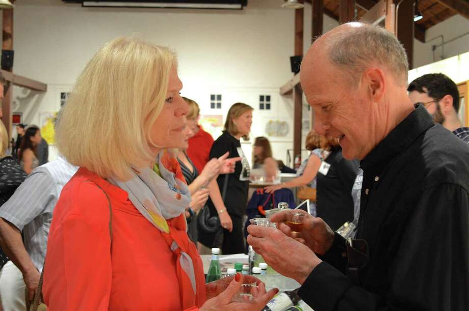 Sandra and Andy Millar of Darien enjoy some drink samples at the Carriage Barn Arts Center's jazz concert, Saturday, June 17, 2017, in New Canaan, Conn. Photo: Jarret Liotta / For Hearst Connecticut Media / New Canaan News Freelance