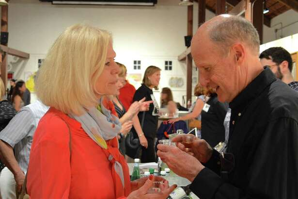 Sandra and Andy Millar of Darien enjoy some drink samples at the Carriage Barn Arts Center's jazz concert, Saturday, June 17, 2017, in New Canaan, Conn.