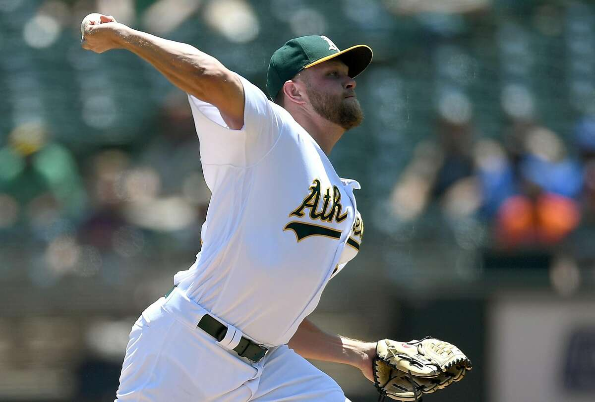 OAKLAND, CA - JUNE 22: Jesse Hahn #32 of the Oakland Athletics pitches against the Houston Astros in the top of the first inning at Oakland Alameda Coliseum on June 22, 2017 in Oakland, California. (Photo by Thearon W. Henderson/Getty Images)