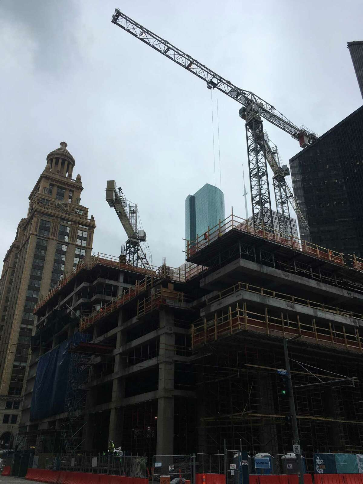 Construction of Capitol Tower continues at 800Capitolin downtown Houston. Since April, five floors of office portion of the 35-story tower have been built and 10 floors of the garage are up. Bank of America will move to the tower in 2019. June 22, 2017 photo.