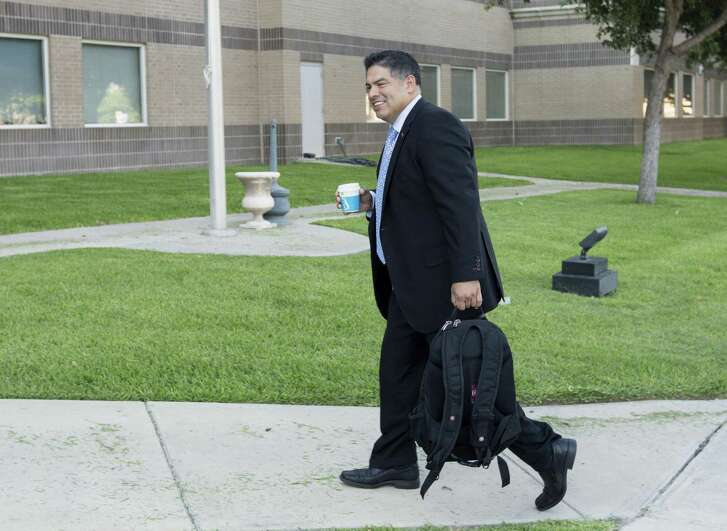 Newly elected District 8 councilman Manny Pelaez enters the federal courthouse in Del Rio Thursday, June 22, 2016 as he prepares to testify in the federal  bribery, wire fraud and conspiracy trial against former Crystal City manager/attorney James Jonas III and former mayor Ricardo Lopez.