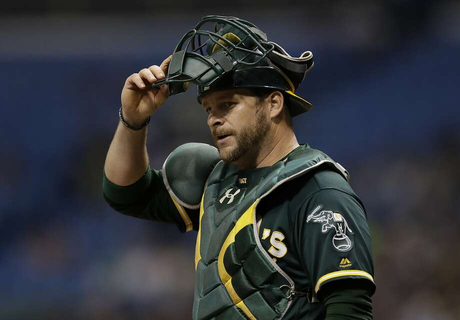 In this file photo, Oakland Athletics catcher Stephen Vogt during the first inning of a baseball game against the Tampa Bay Rays Friday, June 9, 2017, in St. Petersburg, Fla. Free agent catcher Stephen Vogt is returning to the Bay Area, agreeing to a minor league contract with the San Francisco Giants. Vogt shared the news in a text message Monday, Feb. 11, 2019, when he was en route to the club's spring training complex in Scottsdale, Arizona, for Wednesday's pitchers and catchers reporting day. Photo: Chris O'Meara, Associated Press
