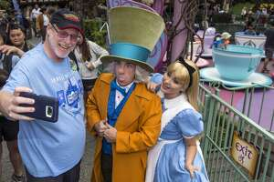 ANAHEIM, Calif. - Thursday, June 22, 2017:  Huntington Beach resident Jeff Reitz, who has visited the parks of the Disneyland Resort every day since January 1, 2012, marked his 2,000th consecutive visit on Thursday. Here, Reitz snaps a selfie with The Mad Hatter and Alice after a teacup ride at the Mad Tea Party in Fantasyland at Disneyland during his 2,000th visit to the park. (Joshua Sudock/Disneyland Resort)