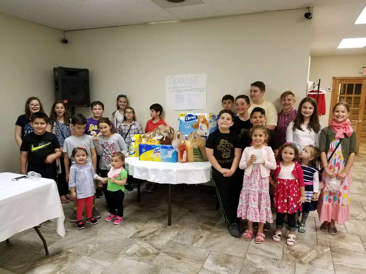 Children at Watervliet's Bosnian cultural center collected supplies for Ronald McDonald House as a good deed for the community during the holy month of Ramadan.