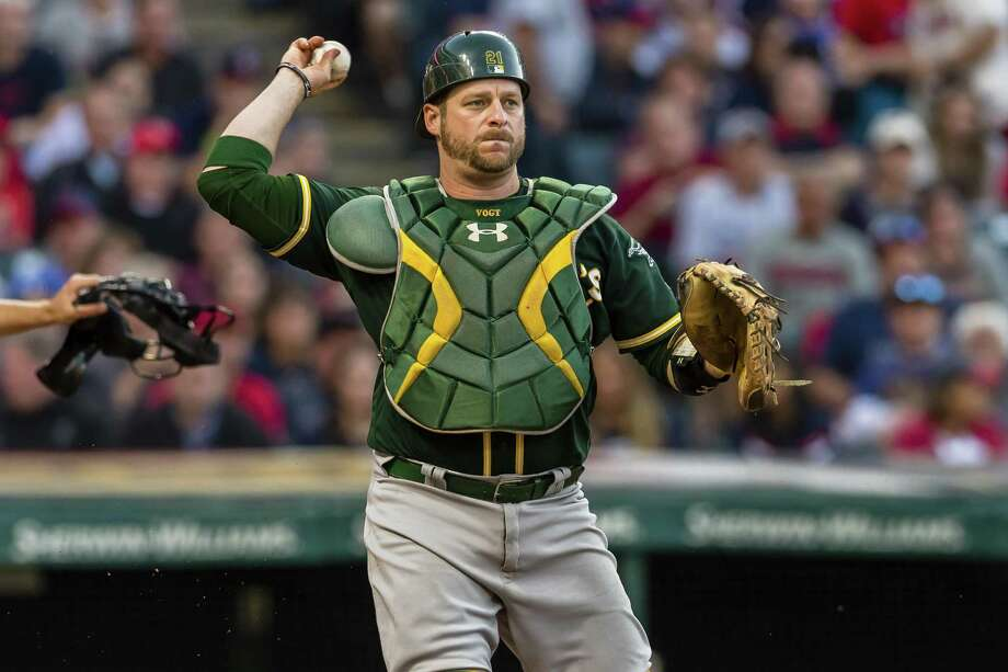 CLEVELAND, OH - MAY 31: Catch Stephen Vogt #21 of the Oakland Athletics throws out Austin Jackson #26 of the Cleveland Indians at first during the eighth inning at Progressive Field on May 31, 2017 in Cleveland, Ohio. The Athletics defeated the Indians 3-1. (Photo by Jason Miller/Getty Images) Photo: Jason Miller / Getty Images / 2016 Jason Miller