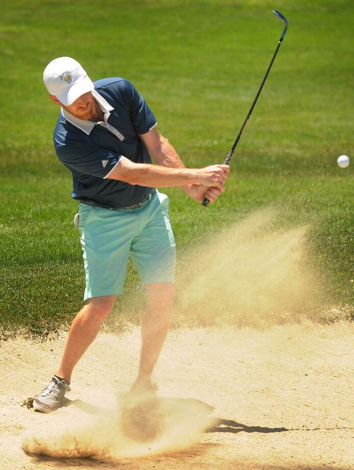 Mike Kennedy, of Milford, pitches from a green side bunker during semifinals match play at the 115th Connecticut Amateur Golf Tournament at Tashua Knolls Golf Course in Trumbull, Conn. on Thursday, June 21, 2017. Photo: Brian A. Pounds / Hearst Connecticut Media / Connecticut Post