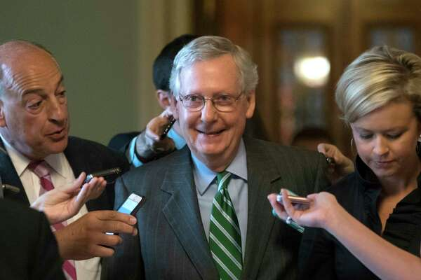 Senate Majority leader Mitch McConnell smiles Thursday after announcing the release of the Republicans' health care bill which represents the GOP's  long-awaited attempt to scuttle much of President Barack Obama's Affordable Care Act. (AP Photo / J. Scott Applewhite)