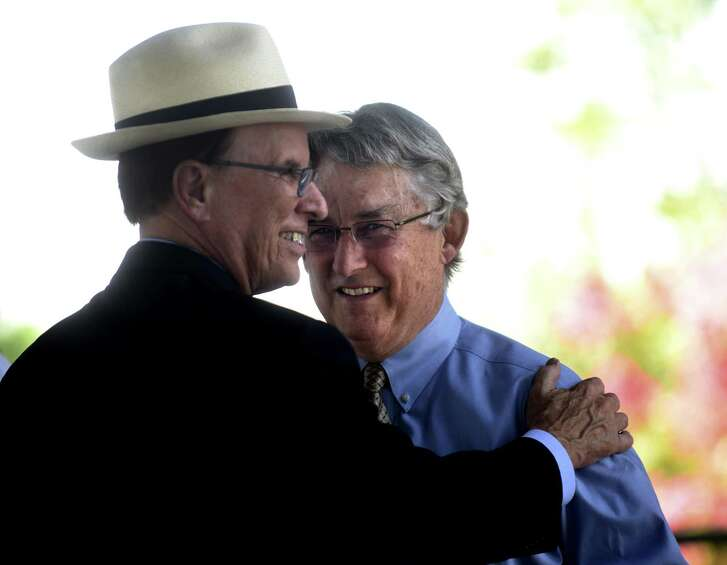 Bexar County Judge Nelson Wolff, an advocate of baseball in San Antonio, greets Pacific Coast League president Branch Rickey before a press conference to announce that San Antonio will host a Pacific Coast League Triple-A baseball team beginning in 2019.