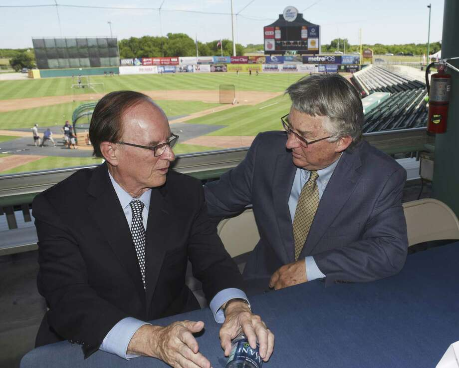 Bexar County Judge Nelson Wolff, an advocate of baseball in San Antonio, left, speaks with Pacific Coast League president Branch Rickey after a press conference to announce that San Antonio will host a Pacific Coast League Triple-A baseball team beginning in 2019. The city is well-suited for Triple-A ball, but should be cautious about public financing for a stadium. Photo: Billy Calzada /San Antonio Express-News / San Antonio Express-News