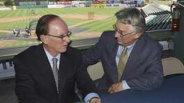 Bexar County Judge Nelson Wolff (left) speaks with Pacific Coast League president Branch Rickey at Wolff Stadium.