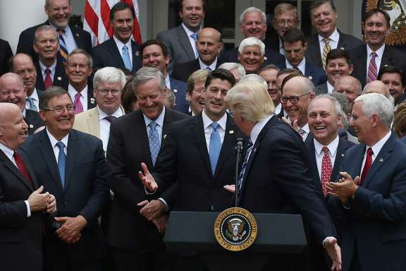President Donald Trump congratulates House Republicans after they passed legislation aimed at repealing and replacing ObamaCare in the Rose Garden on May 4. The end game of accommodating Trump is disaster.