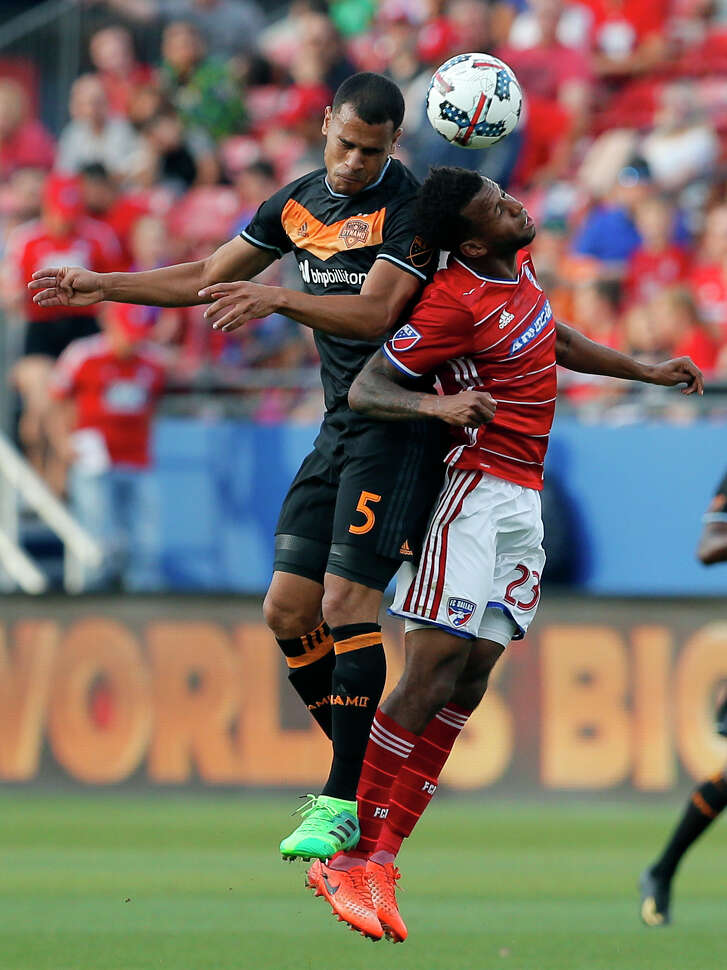 Dynamo midfielder Juan Cabezas, left, and FC Dallas midfielder Kellyn Acosta contest a header during a scoreless tie in Frisco on May 28.