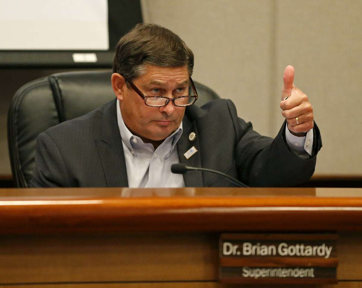 North East Independent School District Superintendent Brian Gottardy gives a thumbs up during a board meeting last June that approved the district's $555.9 million budget for the 2017-18 school year. The spending plan overestimated enrollment this year by about 1,000 students, adding to financial pressures on the district.